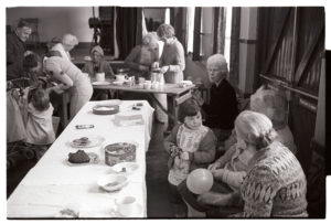 Women and children at Dolton Playgroup coffee morning by James Ravilious