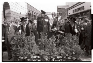 Mayor and dignitaries watching regimental march by James Ravilious