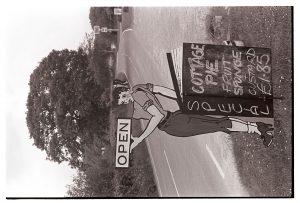 Sign advertising roadside café by James Ravilious