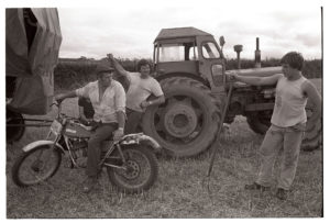 Farmer talking to harvesters by James Ravilious