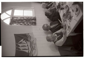 Singing hymns after the Harvest Supper by James Ravilious