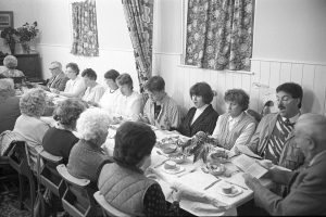 Chulmleigh Congregational Church's Harvest Festival: singing hymns after the Harvest Supper by James Ravilious