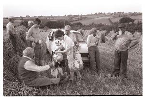 Harvesters' tea break by James Ravilious