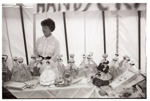 Doll stall at garden fete by James Ravilious