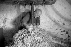 Bill Hammond making cider by James Ravilious