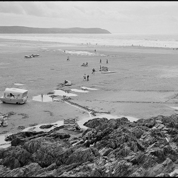 View of beach, ice cream van, Woolacombe, August 1982. Documentary photograph by James Ravilious for the Beaford Archive © Beaford Arts
